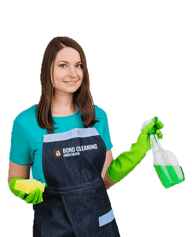 young woman in blue shirt and black apron standing with spray bottle and rag in hand