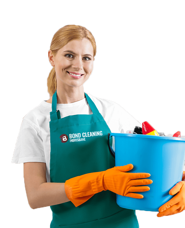 smiling woman wearing green apron holding blue bucket in hands