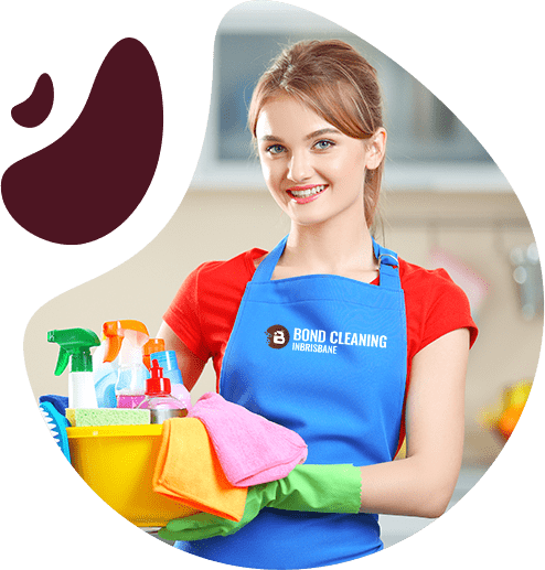 beautiful young woman wearing red top and blue apron holding bucket full of spray bottles and rags