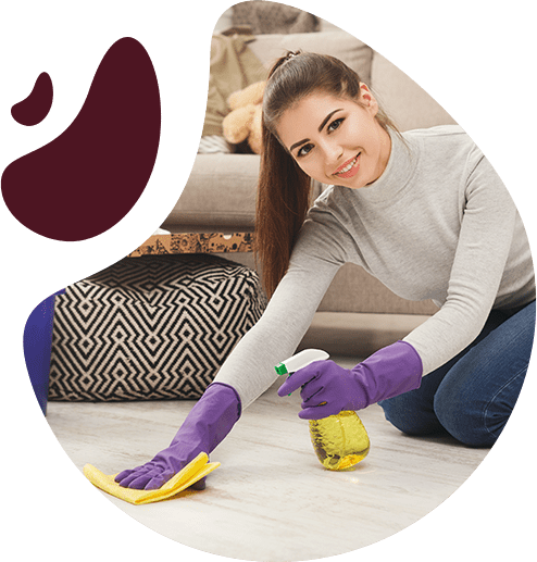 beautiful young woman wiping the surface wearing purple protective gloves