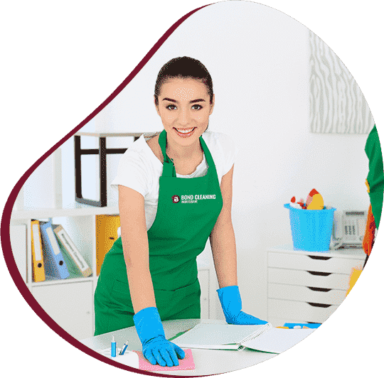 beautiful young woman wiping office table with rag
