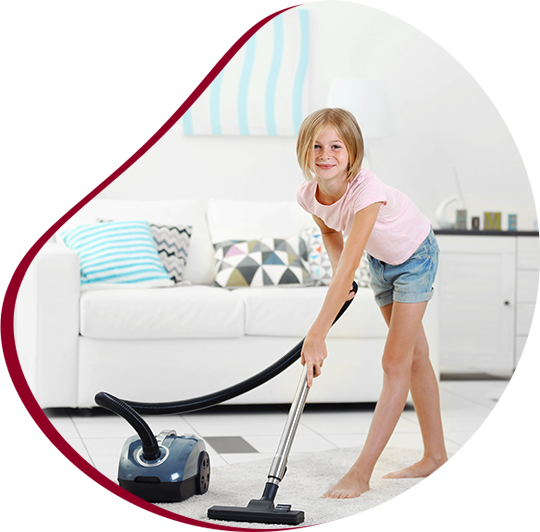 young beautiful woman vacuuming the carpet