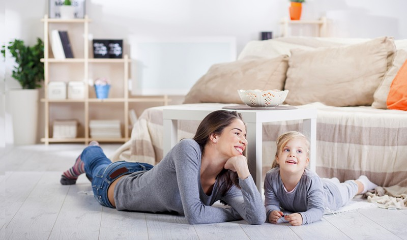 A women with her daughter enjoying at their house