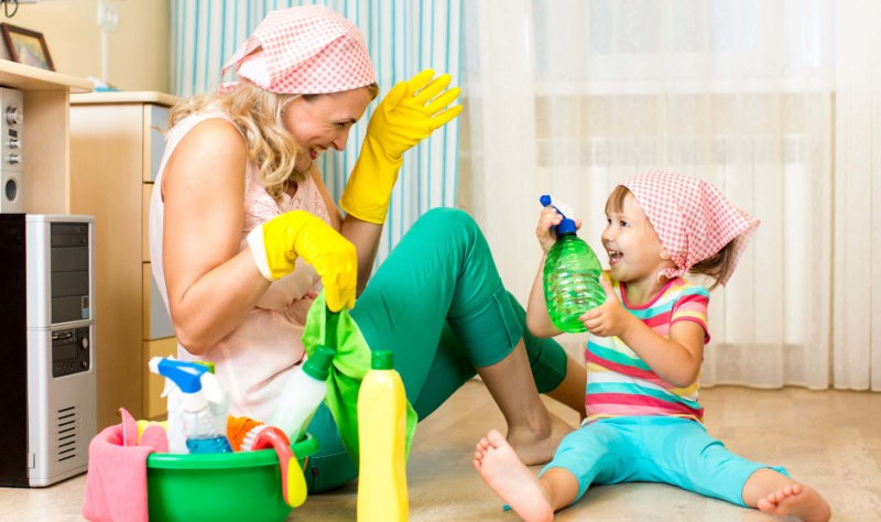 A mom and daughter having fun during cleaning