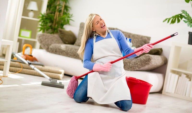 A woman is cleaning her house with fun