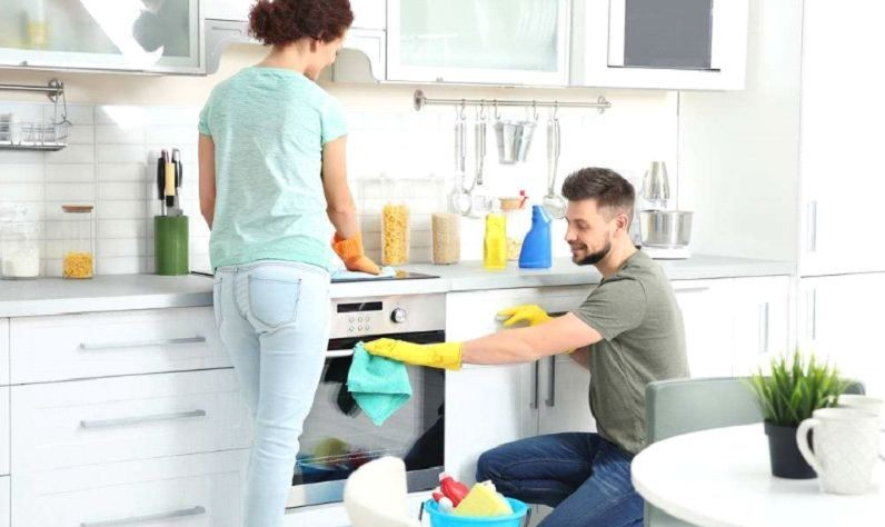 a couple is cleaning a dishwasher