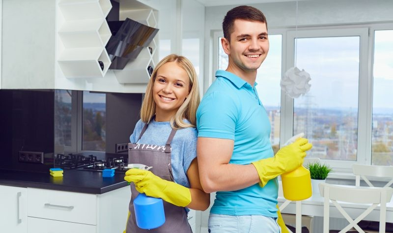 a couple is cleaning their house