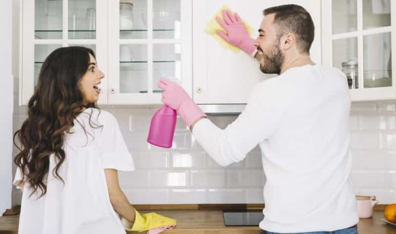 young couple sprucing up their kitchen