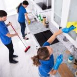 team of professionals sprucing up a kitchen